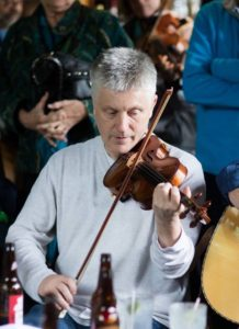 Photo of Andrew O'Brien playing fiddle